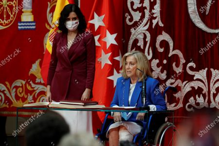 Madrid's regional Family, Youth and Social Politics Minister Concepcion Dancausa (R), next to Madrid's regional President Isabel Diaz Ayuso (L), during the regional Ministers' swear-in ceremony in Madrid, Spain, 21 June 2021. Ayuso won regional snap elections held 04 May 2021.