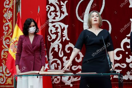 Madrid's regional Culture, Tourism and Sports Minister Marta Rivera de la Cruz (R), next to Madrid's regional President Isabel Diaz Ayuso (L), during the regional Ministers' swear-in ceremony in Madrid, Spain, 21 June 2021. Ayuso won regional snap elections held 04 May 2021.