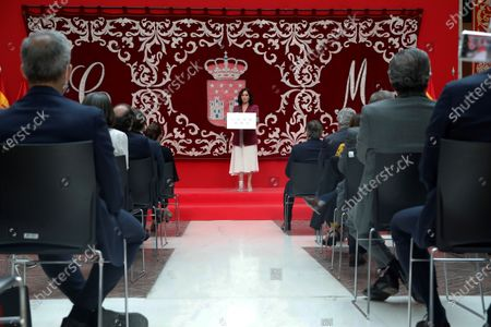Madrid's regional President Isabel Diaz Ayuso (C) delivers a speech during the regional Ministers' swear-in ceremony in Madrid, Spain, 21 June 2021. Ayuso won regional snap elections held 04 May 2021.