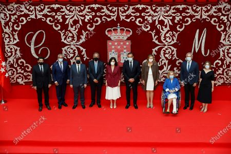 Madrid's regional President Isabel Diaz Ayuso (C) poses for a family photo with her new regional ministers during their swear-in ceremony in Madrid, Spain, 21 June 2021. Ayuso won regional snap elections held 04 May 2021.