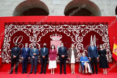 Madrid's regional President Isabel Diaz Ayuso (5-L) poses for a family photo with her new regional ministers during their swear-in ceremony in Madrid, Spain, 21 June 2021. Ayuso won regional snap elections held 04 May 2021.
