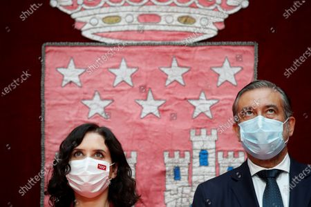 Madrid's regional Justice and Interior Minister Enrique Lopez (R) stands next to Madrid's regional President Isabel Diaz Ayuso (L) during the regional Ministers' swear-in ceremony in Madrid, Spain, 21 June 2021. Ayuso won regional snap elections held 04 May 2021.