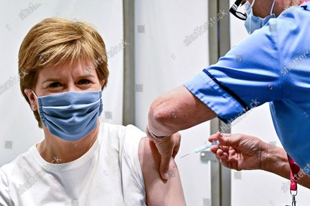 First Minister of Scotland Nicola Sturgeon receives her second dose of the AstraZeneca Covid-19 vaccine, administered by staff nurse Susan Inglis, at the NHS Louisa Jordan vaccine centre in Glasgow, Scotland