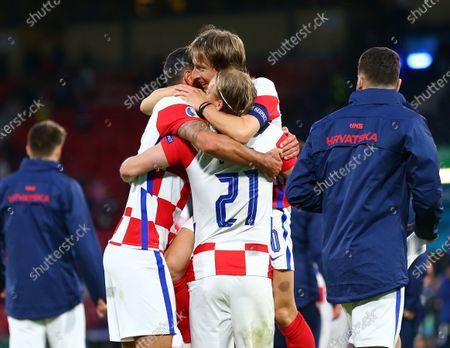Dejan Lovren of Croatia hugs Luka Modric of Croatia after the win; Hampden Park, Glasgow, Scotland; 2020 European Football Championships, Scotland versus Croatia.