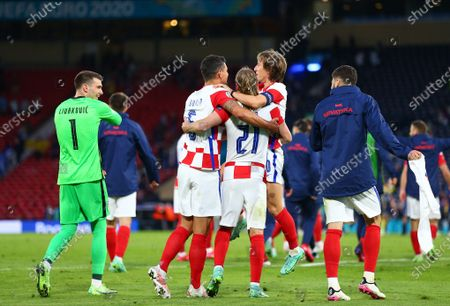 Luka Modric of Croatia is held up by Dejan Lovren and Domagoj Vida of Croatia after the match; Hampden Park, Glasgow, Scotland; 2020 European Football Championships, Scotland versus Croatia.