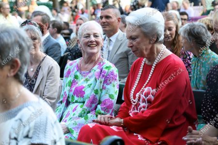 Queen Margrethe II and Princess Benedikte await the re-premiere of 'Tinderbox' at the Pantomime Theater in Tivoli.