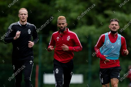 Standard's goalkeeper Arnaud Bodart, Standard's Mehdi Carcela and Standard's Maxime Lestienne pictured during the first training session for the new season 2021-2022 of Jupiler Pro League first division soccer team Standard de Liege, Monday 21 June 2021 in Liege.
