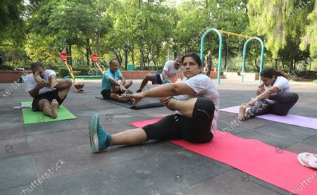 Indian Women perform Archer Pose (Akarna Danurasana), yoga postures to mark the International Yoga Day during the coronavirus pandemic at the District Park. Yoga Day is celebrated across the globe to highlight the importance of Yoga and it help in to keep our body and mind healthy.  The International Yoga has been celebrated annually on 21 June, following its inception in the United Nations General Assembly in 2014. The theme for the International Yoga Day 2021 is decided by the UN Yoga for well-being.