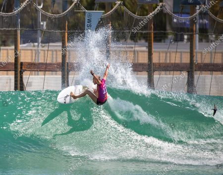 A bird flies by as Keely Andrew, of Australia, does a snapping turn off the top of a wave while competing in the women's qualifying rounds Saturday at the Jeep Surf Ranch Pro presented by Adobe at the Kelly Slater WSL Surf Ranch June 19, 2021 in Lemoore, CA. (Allen J. Schaben / Los Angeles Times)