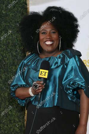 Sheryl Underwood with ET microphone promoting co-hosting appearance