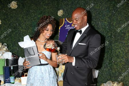 Stock Photo of Nischelle Turner with MAC Products, and Kevin Frazier with Four Roses Bourbon