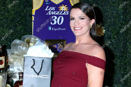 Stock Photo of Melissa Claire Egan and MAC bag