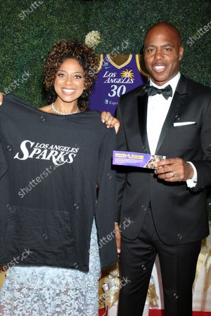Nischelle Turner with LA Sparks Pullover, and Kevin Frazier with LA Sparks tickets