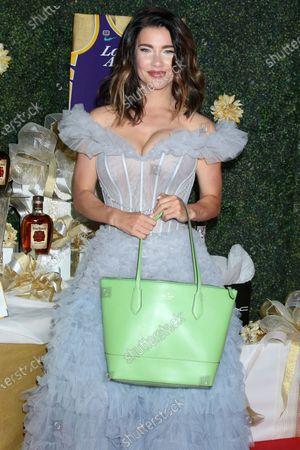 Jacqueline MacInnes Wood with Kate Spade purse