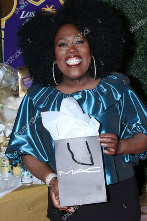 Sheryl Underwood with M.A.C makeup