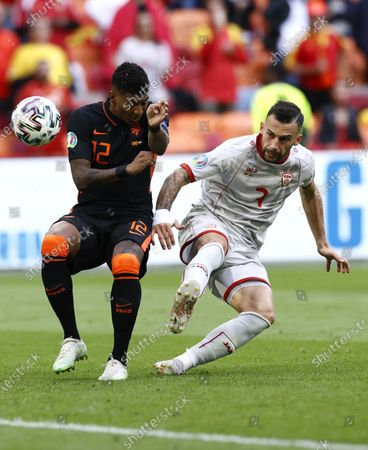 Patrick van Aanholt (L) of the Netherlands in action against Ivan Trichkovski of North Macedonia during the UEFA EURO 2020 preliminary round group C soccer match between North Macedonia and the Netherlands in Amsterdam, Netherlands, 21 June 2021.