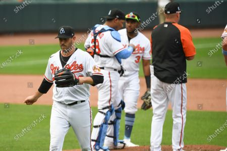 Baltimore Orioles starting pitcher Matt Harvey (left) is removed from the game by manager Brandon Hyde during the fifth inning of baseball game against the Toronto Blue Jays, in Baltimore