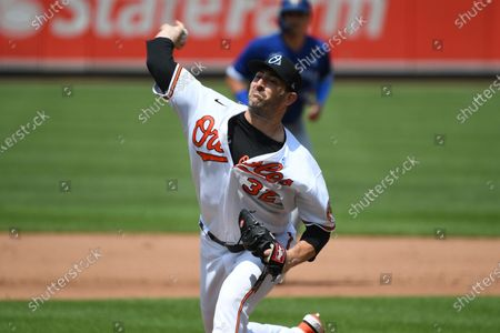 Baltimore Orioles starting pitcher Matt Harvey (32) throws a pitch during the fifth inning of a baseball game against the Toronto Blue Jays, in Baltimore
