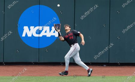 Stanford's Christian Robinson (44) catches a sacrifice fly from Arizona's Tanner O'Tremba in the sixth inning during a baseball game in the College World Series, at TD Ameritrade Park in Omaha, Neb