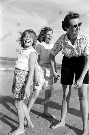 Louise Brewer Shepard, wife of astronaut Alan B. Shepard, Jr., making silly faces with her daughters, 11-year-old Laura and 8-year-old Julie, on the beach near their home in Virginia Beach, Virginia, April 1959.