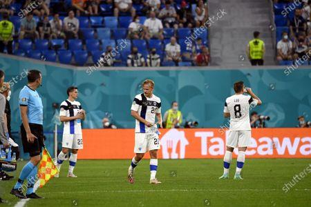 Jukka Raitala (L), Joel Pohjanpalo and Robin Lod of Team Finland have a water break during the UEFA Euro 2020 football tournament group B match Finland vs Belgium at Saint Petersburg stadium in Saint Petersburg, Russia on June 21, 2021.