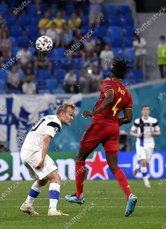Joel Pohjanpalo (L) of Team Finland vies the ball with Dedryck Boyata of Belgium during the UEFA Euro 2020 football tournament group B match Finland vs Belgium at Saint Petersburg stadium in Saint Petersburg, Russia on June 21, 2021.