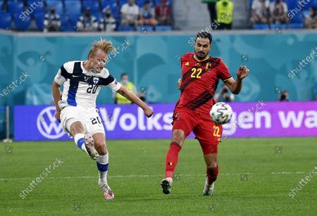 Joel Pohjanpalo (L) of Team Finland vies with Nacer Chadli of Belgium during the UEFA Euro 2020 football tournament group B match Finland vs Belgium at Saint Petersburg stadium in Saint Petersburg, Russia on June 21, 2021.