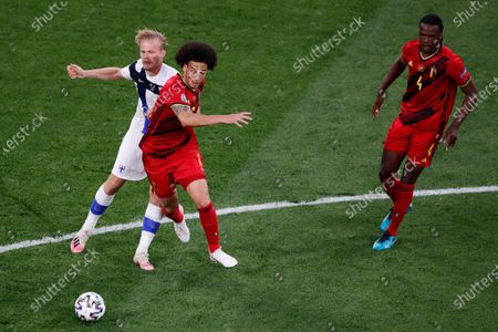 Belgium's Axel Witsel, center, fights for the ball with Finland's Joel Pohjanpalo during the Euro 2020 soccer championship group B match between Finland and Belgium at Saint Petersburg Stadium in St. Petersburg, Russia