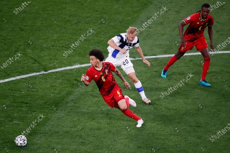Belgium's Axel Witsel, left, is challenged by Finland's Joel Pohjanpalo during the Euro 2020 soccer championship group B match between Finland and Belgium at Saint Petersburg Stadium in St. Petersburg, Russia