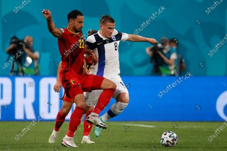 Belgium's Nacer Chadli, left, fights for the ball with Finland's Robin Lod during the Euro 2020 soccer championship group B match between Finland and Belgium at Saint Petersburg Stadium in St. Petersburg, Russia