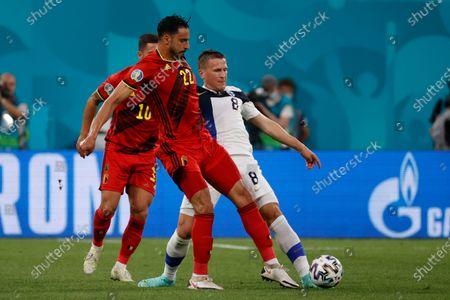Finland's Robin Lod, right, fights for the ball with Belgium's Nacer Chadli during the Euro 2020 soccer championship group B match between Finland and Belgium at Saint Petersburg Stadium in St. Petersburg, Russia