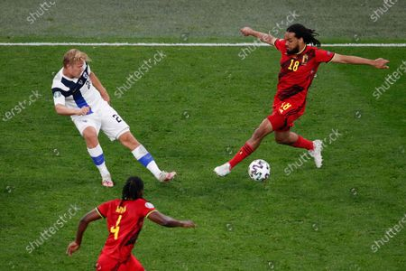 Belgium's Jason Denayer, right, is challenged by Finland's Joel Pohjanpalo during the Euro 2020 soccer championship group B match between Finland and Belgium at Saint Petersburg Stadium in St. Petersburg, Russia