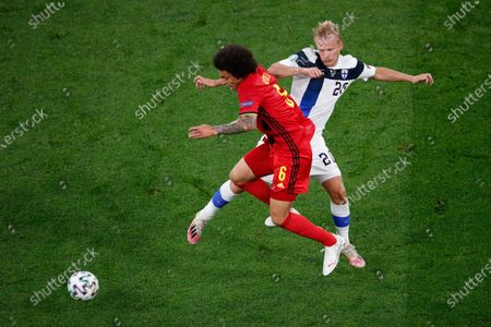 Belgium's Axel Witsel, left, fights for the ball with Finland's Joel Pohjanpalo during the Euro 2020 soccer championship group B match between Finland and Belgium at Saint Petersburg Stadium in St. Petersburg, Russia
