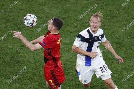 Belgium's Thomas Vermaelen, left, controls the ball past Finland's Joel Pohjanpalo during the Euro 2020 soccer championship group B match between Finland and Belgium at Saint Petersburg Stadium in St. Petersburg, Russia