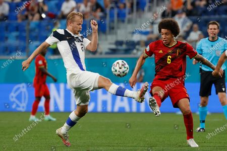 Belgium's Axel Witsel, right, fights for the ball with Finland's Joel Pohjanpalo during the Euro 2020 soccer championship group B match between Finland and Belgium at Saint Petersburg Stadium in St. Petersburg, Russia