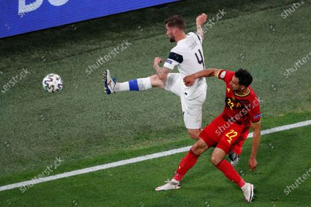 Finland's Joona Toivio, top, clears the ball past Belgium's Nacer Chadli during the Euro 2020 soccer championship group B match between Finland and Belgium at Saint Petersburg Stadium in St. Petersburg, Russia