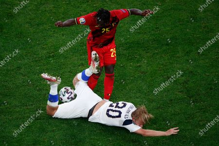 Finland's Joel Pohjanpalo, bottom, is challenged by Belgium's Jeremy Doku during the Euro 2020 soccer championship group B match between Finland and Belgium at Saint Petersburg Stadium in St. Petersburg, Russia