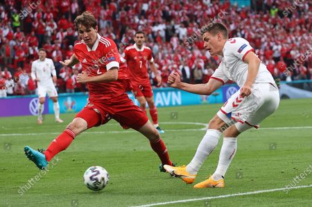 Joakim Maehle (R) of Denmark in action against Mario Fernandes of Russia during the UEFA EURO 2020 group B preliminary round soccer match between Russia and Denmark in Copenhagen, Denmark, 21 June 2021.