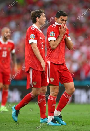 Russian players Mario Fernandes (L) and Magomed Ozdoyev (R) react during the UEFA EURO 2020 group B preliminary round soccer match between Russia and Denmark in Copenhagen, Denmark, 21 June 2021.