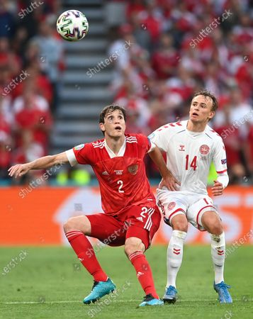 Mario Fernandes (L) of Russia in action against Mikkel Damsgaard (R) of Denmark during the UEFA EURO 2020 group B preliminary round soccer match between Russia and Denmark in Copenhagen, Denmark, 21 June 2021.
