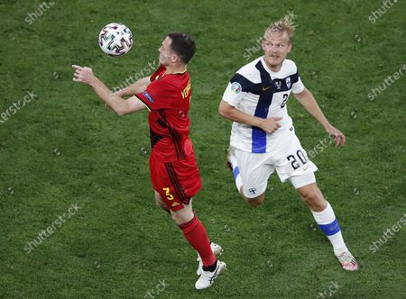 Joel Pohjanpalo (R) of Finland in action against Thomas Vermaelen of Belgium during the UEFA EURO 2020 group B preliminary round soccer match between Finland and Belgium in St.Petersburg, Russia, 21 June 2021.
