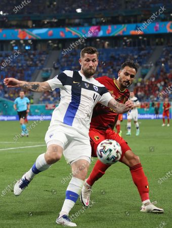 Joona Toivio (L) of Finland in action against Nacer Chadli of Belgium during the UEFA EURO 2020 group B preliminary round soccer match between Finland and Belgium in St.Petersburg, Russia, 21 June 2021.