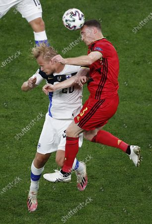 Joel Pohjanpalo (L) of Finland in action against Thomas Vermaelen of Belgium during the UEFA EURO 2020 group B preliminary round soccer match between Finland and Belgium in St.Petersburg, Russia, 21 June 2021.