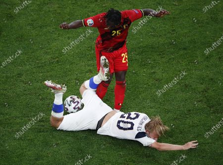Joel Pohjanpalo (bottom) of Finland in action against Jeremy Doku of Belgium during the UEFA EURO 2020 group B preliminary round soccer match between Finland and Belgium in St.Petersburg, Russia, 21 June 2021.