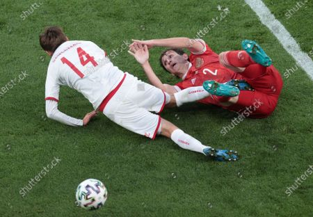 Russia's Mario Fernandes, right, and Denmark's Mikkel Damsgaard challenge for the ball during the Euro 2020 soccer championship group B match between Russia and Denmark at the Parken stadium in Copenhagen, Denmark