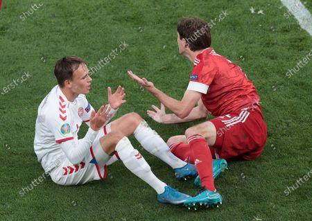 Stock Image of Russia's Mario Fernandes, right, and Denmark's Mikkel Damsgaard react during the Euro 2020 soccer championship group B match between Russia and Denmark at the Parken stadium in Copenhagen, Denmark