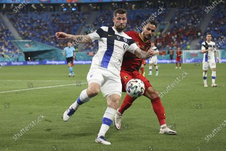 Finland's Joona Toivio, left, and Belgium's Nacer Chadli challenge for the ball during the Euro 2020 soccer championship group B match between Finland and Belgium at Saint Petersburg stadium, in St. Petersburg, Russia