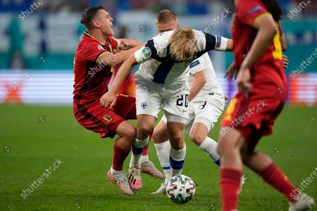 Belgium's Leandro Trossard, left, tries to stop Finland's Joel Pohjanpalo during the Euro 2020 soccer championship group B match between Finland and Belgium at Saint Petersburg stadium, in St. Petersburg, Russia