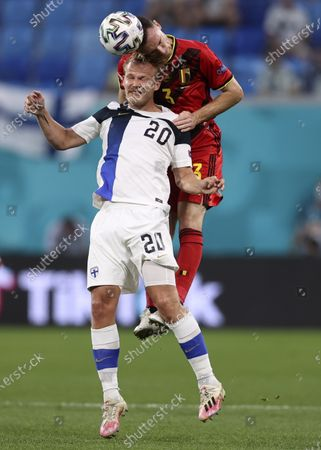 Belgium's Thomas Vermaelen, background, and Finland's Joel Pohjanpalo jump for the ball during the Euro 2020 soccer championship group B match between Finland and Belgium at Saint Petersburg stadium, in St. Petersburg, Russia