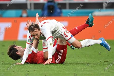 Stock Picture of Denmark's Mikkel Damsgaard, top, is tackled by Russia's Mario Fernandes during the Euro 2020 soccer championship group B match between Russia and Denmark at the Parken stadium in Copenhagen, Denmark
